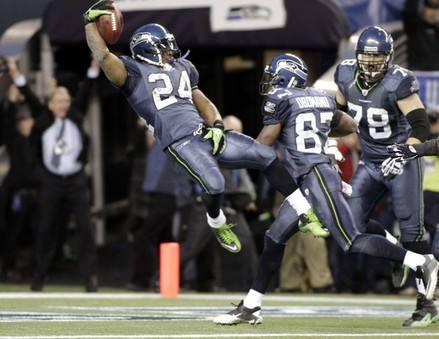 Seattle Seahawks Running Back Marshawn Lynch #24 diving into the end zone.