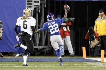 New York Giants' Running Back David Wilson #22 returns kickoff for touchdown